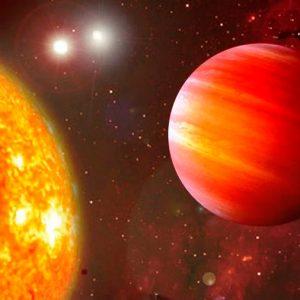 Un nuevo planeta rocoso se sofoca bajo tres soles rojos a 22 años luz